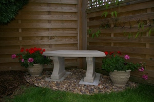 Stone Curved Seat & small planters.